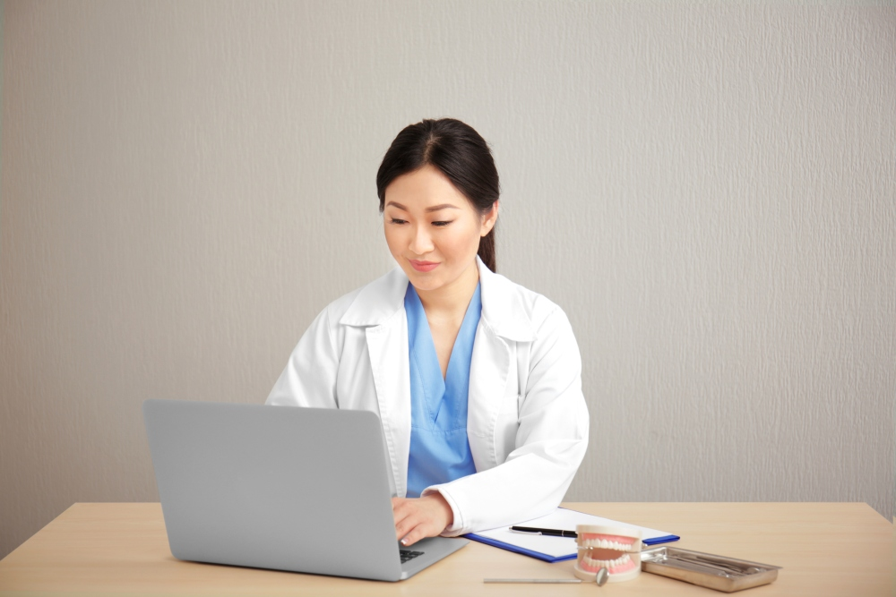 Dentist using laptop